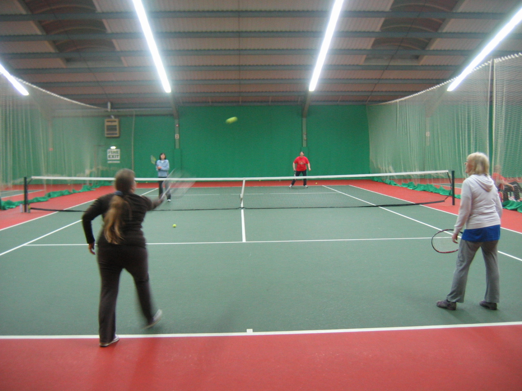 Playing doubles tennis pic